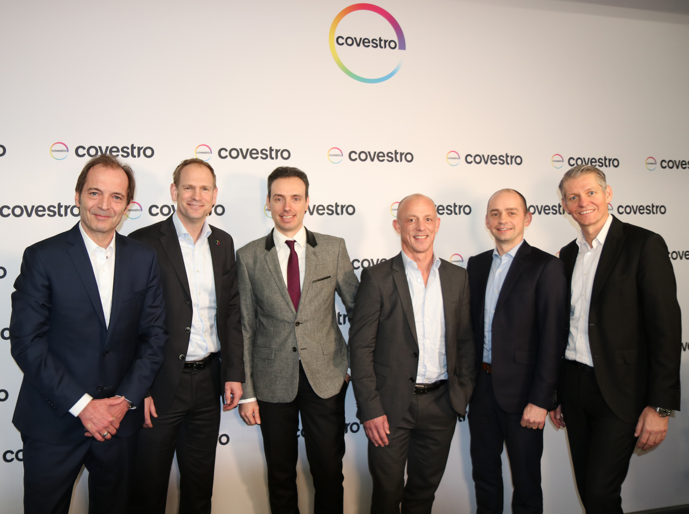 Dr. Thorsten Dreier, global head of Covestro´s special films business (second from left), and Cosimo Prete, president and founder of C.S.T (third from left). (Source: Covestro)
