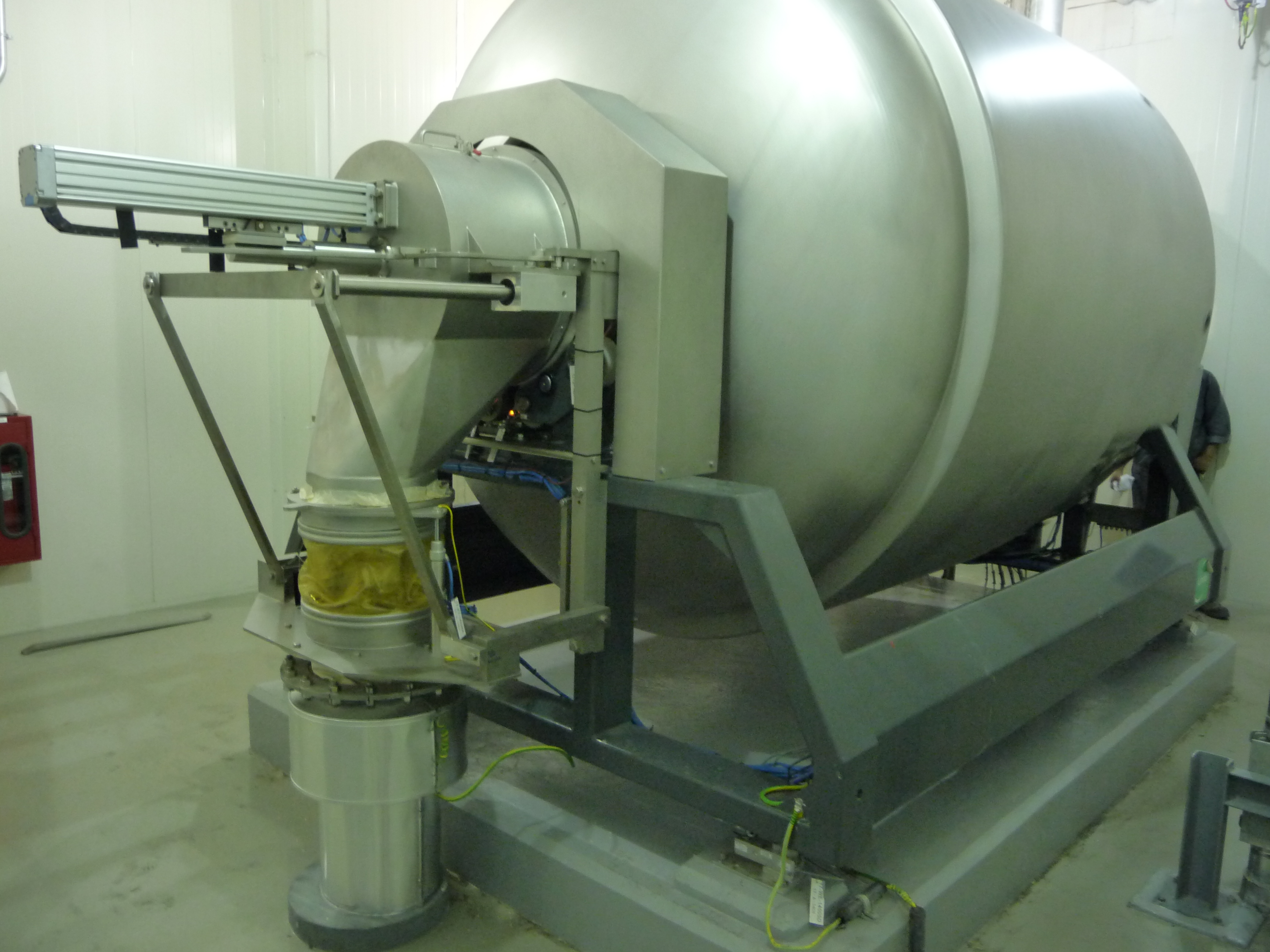 A gentle touch mixer from Lindor Products consists of an inlet, horizontal rotating vessel or drum and a fixed outlet.
