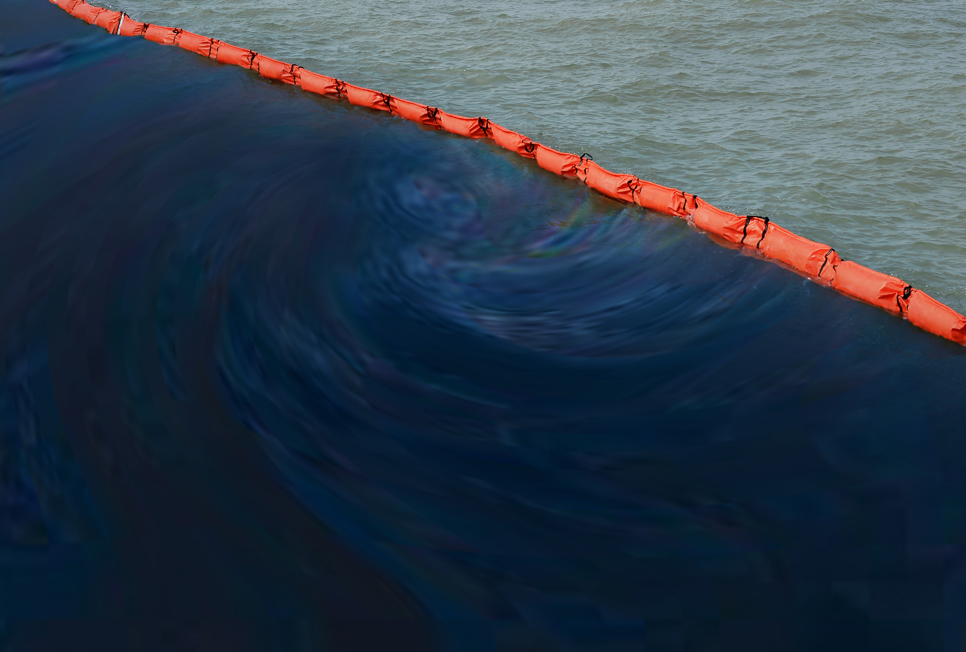 BASF's Tinuvin range of plastic additives help to increase the lifespan of oil spill barriers under intense sunlight (Source: BASF)
