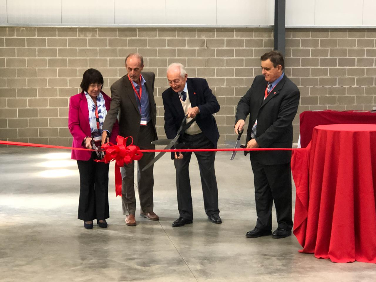 Ribbon-cutting ceremony (f.l.t.r.): Carla Lucente, Honorary Consul of Italy in Western Pennsylvania, Bruce Mazzoni, Cranberry Supervisor, Marco Volpato, President of Cannon, Paolo Spinelli, President of Cannon USA.(Source: Cannon)