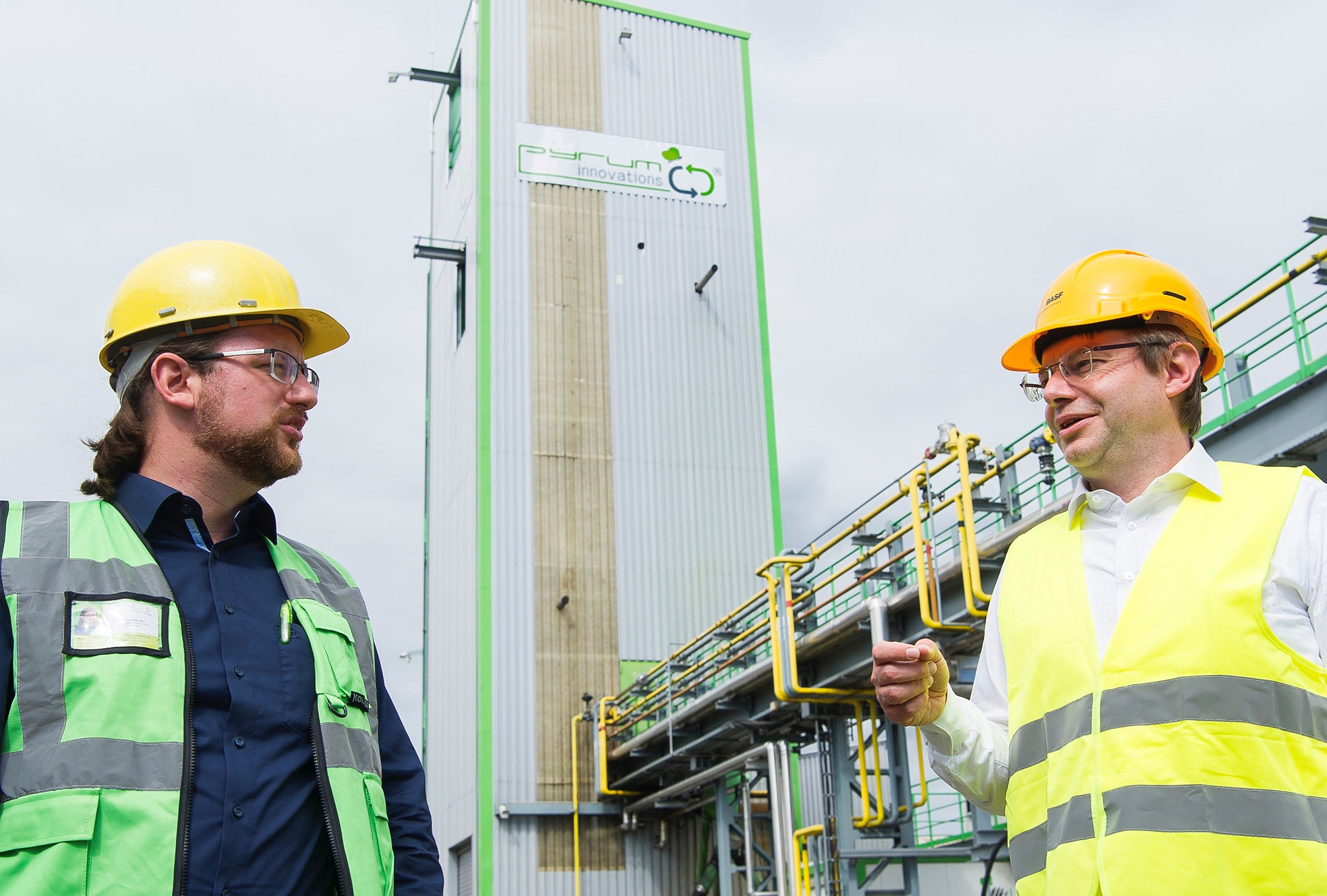 Pascal Klein (left), Founder and CEO of Pyrum Innovations AG and Dr. Christian Lach (right), Project Lead ChemCycling at BASF, in front of Pyrum's tyre pyrolysis plant in Dillingen/Saar, Germany. (Source: BASF)