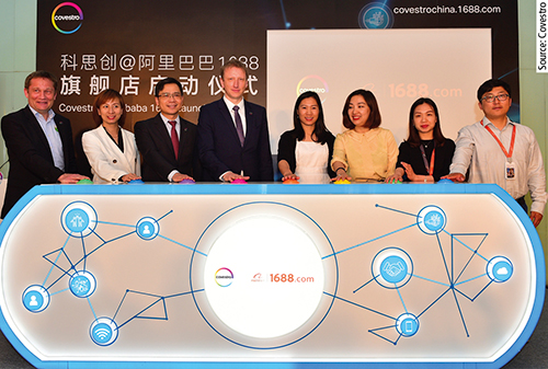 A team of Alibaba and Covestro presses the release button.