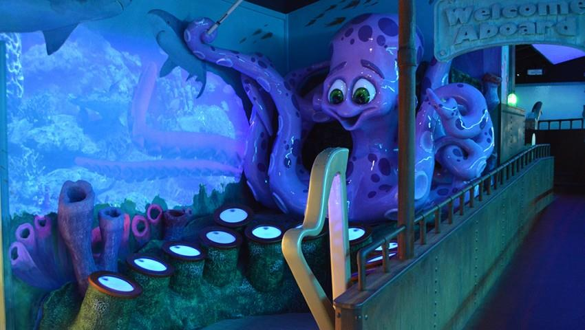 Drumming to the beat with Octavia the octopus at Greensboro Science Center's underwater themed exhibit (Source: Ruocchio Designs)